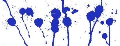 Blue ink splash. Paint splatter. Blue blots on white. Ink stains Royalty Free Stock Photos