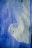 Blue ink stain on a sheet of white paper, macro Royalty Free Stock Image