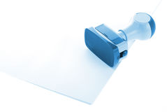 Blue Ink stamp over white paper royalty free stock photos