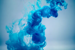 Blue ink underwater. As abstract background for your project royalty free stock photo