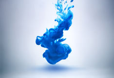 Blue ink underwater Royalty Free Stock Images