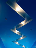 Blue interior. Blue decorative ceiling with halogen lamps Stock Images
