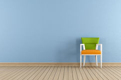 Blue room with colorful chair Royalty Free Stock Photo