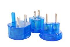 Blue international plugs isolated on white. Blue transparent international plugs isolated on white background Stock Images