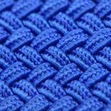 Blue Interwoven Texture. A super macro shot of blue interwoven fabric texture – square image Stock Photo