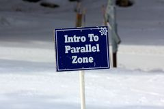 Blue Intro To Parallel Zone Sign on the Ski Slopes Stock Photography
