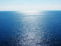 Blue ionian sea view with sun beams on Corfu island Stock Images
