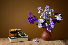 Blue Iris, a book and a box with jewelry Stock Photo
