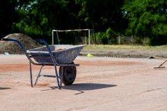 Blue iron cart full of sand Stock Image