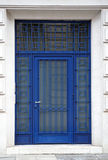 Blue iron door entrance with white walls Stock Photos