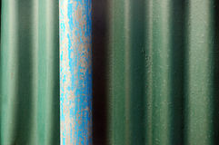 Blue iron pipe. On the  wall Royalty Free Stock Photos