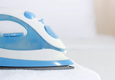 Blue iron to iron the towel Royalty Free Stock Photography