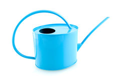 Blue iron watering can. Isolated on white background royalty free stock photography