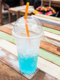 Blue italian soda in plastic cup Royalty Free Stock Photography