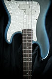 Blue and ivory bass guitar Stock Image