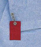 Blue jacket. With red price tag label royalty free illustration