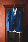 Blue Jacket on Wardrobe. Male blue jacket ans shirt on wardrobe Stock Photography
