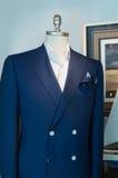 Blue Jacket, White Shirt and Handkerchief. Blue jacket with white buttons; white shirt and blue patterned handkerchief Stock Photo