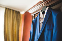 Blue Jacket and White SHirt. On wardrobe Royalty Free Stock Photography