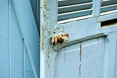 Blue jalousie door stock image