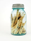 Blue jar with clothes pins Royalty Free Stock Photo