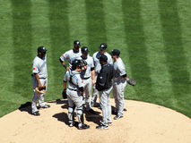 Blue Jays have a meeting on the mound Stock Image