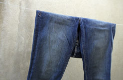 Blue jean on clothes line Stock Images