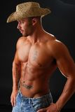 Blue Jean Cowboy. A muscular cowboy without a shirt Royalty Free Stock Image