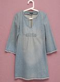 Blue jean dress on hanger Royalty Free Stock Image