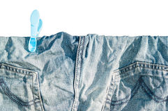 A blue jean drying at the sun Royalty Free Stock Photo