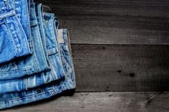 Blue jean and jean lack texture on the wooden floor Stock Photography