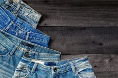 Blue jean and jean lack texture on the wooden floor Stock Photos