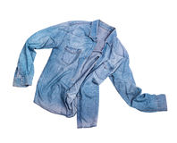 Blue jean male shirt isolated on white. Blue jean male shirt isolated on a white Royalty Free Stock Photos