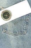 Blue jean with paper and compass. On the pocket Stock Photography