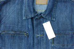 Blue jean shirt with empty tag for background. Blue jean shirt with empty tag for background Stock Images