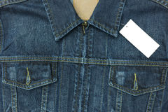 Blue jean shirt with empty tag for background. Blue jean shirt with empty tag for background Stock Photo