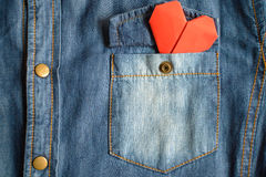Blue jean shirt with pocket and red heart Stock Images