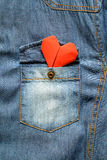 Blue jean shirt with pocket and red heart Royalty Free Stock Images