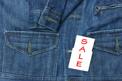 Blue jean shirt with sale tag for background. Blue jean shirt with sale tag for background Stock Photography