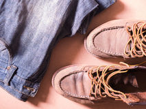 Blue jean with still life of old leather boots, work harder men style Stock Photography