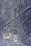 Blue jean texture with a hole and threads showing Stock Photo
