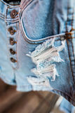 Blue jean texture with a tear. Stock Images