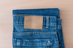 Blue jean on wood background Royalty Free Stock Photo