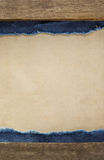 Blue jean on wood texture Stock Image