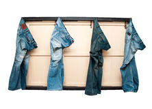 Blue jeans. Four Blue jeans on windows Royalty Free Stock Images