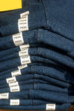 Blue Jeans. Folded neatly in a store with (very small) sized marked Royalty Free Stock Image