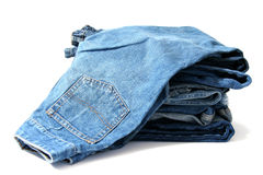 Blue jeans. Pile of trousers made of blue denim jeans Royalty Free Stock Image