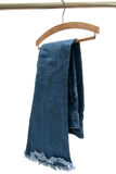 Blue jeans. Trousers made of blue denim jeans hanging Royalty Free Stock Photography
