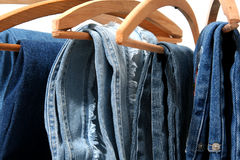 Blue jeans. Trousers made of blue denim jeans hanging stock photos