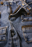 Blue Jeans. Front view of a pair of womens low rise blue jeans Royalty Free Stock Images